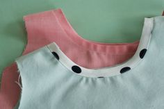 Using bias tape to finish necklines (either decorative or purely functional) - from The Coletterie