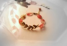 Items similar to The bracelet of peace.Gorgeous pink bracelet gold with olive branch connector.(handmade) on Etsy Trending Outfits, Unique Jewelry, Bracelets, Handmade Gifts, Pink, Gold, Etsy, Vintage, Kid Craft Gifts