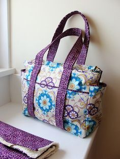 watermelon wishes ULTIMATE diaper bag.  LOVE! She also sells a PDF for her other bag, Love this one b/c it has MORE pockets and stroller straps they are a MUST!