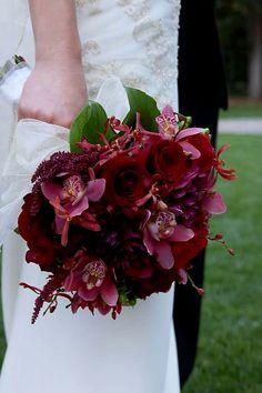 Bride's Elegant Bouquet Showcasing: Red Roses, Red Orchids, Cranberry Dahlias, Hot Pink Cymbidium Orchids, Marsala Amaranthus, Green Foliage
