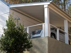 Classic Southern wagon sheds inspired the form of this modern farmhouse garage.