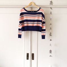 Cropped Sweater Adorable lightweight Roxy sweater. Navy, coral, and white stripes. Cropped fit. Roxy Tops