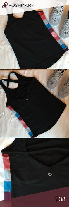 """Lululemon shape tank with block quilting Lululemon shape tank with block quilting. Previously loved, but still in good condition. Color blocking down one side. Built in bra. Criss cross back with cute strap across back. Garment info is pretty worn off of interior bra (pictured). This is an older style. No size dot but bust measures approx 30"""", which is a size 2 according to Lulu size chart. Some signs of wear, but overall good condition. Some cracking in back Lulu logo. lululemon athletica…"""