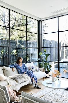 The floor-to-ceiling windows, made by Steel Window Design, let the light into the living room of this Victorian terrace.