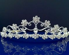 """SparklyCrystal Bridal Wedding Crystal Tiara 72757 by SparklyCrystal. $24.99. Measures approximately 1-1/2"""" tall at the center.. Metal combs at both side of the tiara for extra security.. Made with high quality clear Austrian crystals in silver plated metal setting.. The SPARKLYCRYSTAL tiara comes in a keepsake presentation round clear plastic box. It's a great display for your precious tiara and to keep your pleasant memory forever.. The beautiful tiara is measures appro..."""