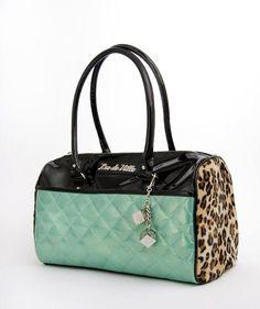 Mint green sparkle vinyl AND furry leopard print Lux De Ville purse. I am drooling.