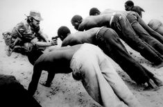 "Rhodesia - ""They line up in push-up stance. They're holding that position for 45 minutes in the sun, many of them starting to shake violently. Eventually, the first guy fell. They took him around the back of the building, knocked him out and fired a shot into the air. They continued bring men to the back of the building. The poor guy on the end started crying and going crazy and he finally broke and started talking."" J.Ross Baughman 1977"