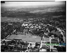 Aerial view of the University of Kentucky campus, 1945-1946. Avenue of Champions runs left to right near the bottom of the photograph with Stoll Field and McLean Stadium, center, lower left. It was the home of the University of Kentucky Wildcats football team. The field hasd been in use since 1880, but the concrete stands were opened in October 1916, and closed following the 1972 season, and was replaced by Commonwealth Stadium.  This was taken prior to Memorial Coliseum which was built in…