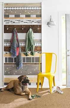 Make a statement at your home's entrance with this eye-catching mix of tiles and wood that doubles as a coatrack.