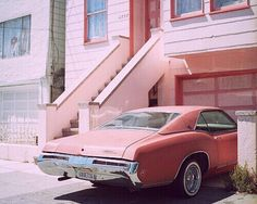 Old pink car & a pink building