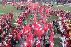 The Cougar Football team enters Martin Stadium for the 2011 Homecoming Game.