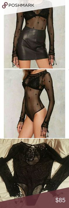 Nastygal beaded bodysuit. sheer black fishnet and features beading detail, beaded fringe, scoop neck, and back cutout. Back button closure, snap crotch closure, thong style. Brand new Tags attached, liner in tact. No snags or signs of wear. Nasty Gal Intimates & Sleepwear