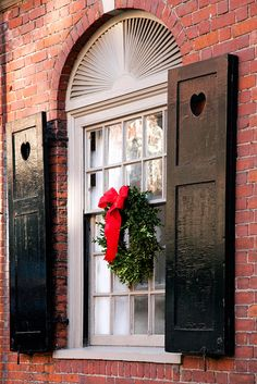 A classic window decoration...and i adore the shutters.
