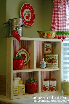 cottage collectibles - i have that cherry plate on the wall -- like the striped paper in back of the cabinet