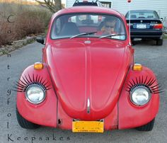 My sister put eyelashes on her old VW Beetle. <3!!!
