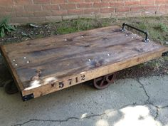 Handmade cart from reclaimed pine atop Vintage Cast Iron Railroad Cart Wheels. Coffee table/Shop Display