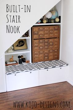 Put that awkward space under the stairs to good use- add built in book shelves, a bench and a small closet