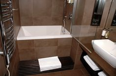 Bathroom. corner square bath up on the brown tile base combined with shower plus brown vanity with shelf and white sink. Captivating Bathtub Ideas For A Small Bathroom Bring A Smart Solution For You