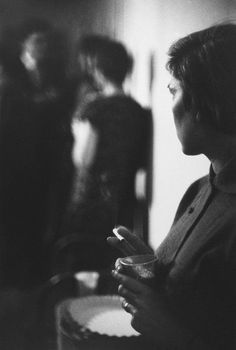 Photo by Saul Leiter. Barbara Smoking, 1955