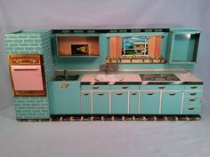 Vintage Superior by T Cohn Tin Children's Toy Modern Kitchen Play Set, OK not only is it pink & Aqua, but look at the atomic ranch home in the window!