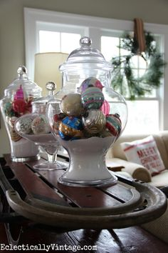 Christmas Shiny Brites on display in a collection of apothecary jars from HomeGoods eclecticallyvintage.com HappybyDesign sponsored
