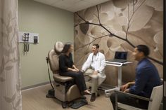 Exam rooms without direct access to daylight were provided wall murals of nature images to promote a calming environment. Additionally, placement of furniture and a mobile workstation in each room are designed to foster a team or peer-to-peer relationship between caregivers, patients, and family members. Photo: Art Gray Photography.