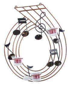 Contemporary Musical Notes Tealight Holder Metal Wall Art Sculpture by UKM Gifts. $27.18. Beautiful musical notes tealight holder. A truly distinctive piece. Metal wall hanging. New and boxed. Height: 42cm- Width: 34cm. Wonderful genuine contemporary musical notes tealight holder metal wall hanging sculpture.  A truly distinctive piece. - Height: 42cm - Width: 34cm - All measurements are approximate.