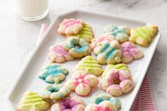 Rectangular pan filled with spritz cookies topped with bright pink, green, blue and purple sprinkles