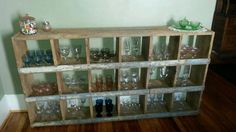 chicken nesting boxes from our old farm converted to hold my antique glass collection