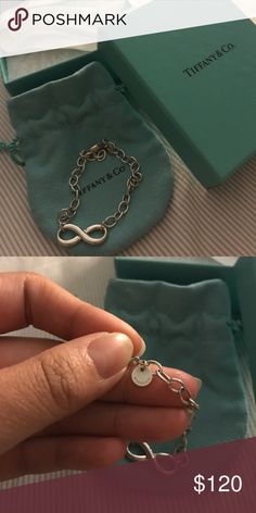 Tiffany & Co. Infinity Bracelet Authentic Tiffany & Co. Infinity bracelet, sterling silver. In great condition. Includes box, pouch, and white ribbon. ✨ Tiffany & Co. Jewelry Bracelets