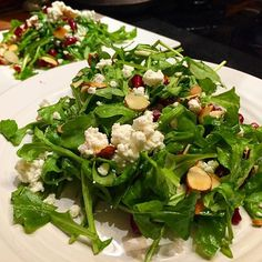 Every great party starts with a gorgeous green arugula salad...dressed in the finest extra virgin olive oil and vinegar vinaigrette @goldenislesoliveoil and decorated with pomegranate arils toasted sliced almonds and crumbled goat cheese.  As they say even though my team lost I still feel good about that dang salad I ate. As quoted by Chef Megan as her home team forgot to heed her salad advice. @vikings