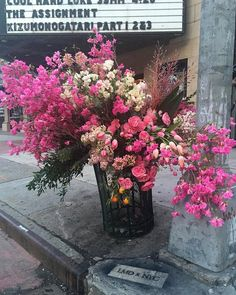 lewis miller has been turning empty garbage cans into voluminous vases overflowing with colorful blooms and lush greenery.