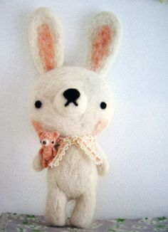 The bunny is cute, in and of itself, but the fact that it has a mini-toy is freaking adorable.