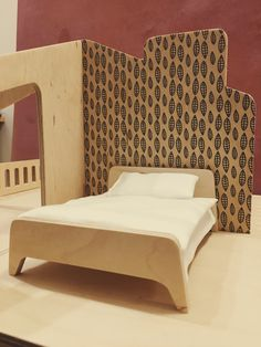 KnockKnock modern wooden dollhouse, furniture inside made from plywood. Print on plywood is ade with silkscreen method