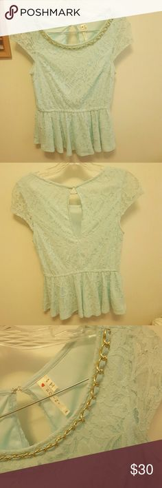 """Baby Blue Peplum Lace Blouse This blouse is absolutely breathtaking. I am heartbrokwn to list it but it does not fit me. This top is completely lace, but only the sleeves are see through. There is a gold chain at the top of it and there is a keyhole back with a clasp at the top, in perfect condition. This peplum top was originally purchased at a boutique and has only been worn a handful of times. Size medium from """"Point"""" Point Tops Blouses"""