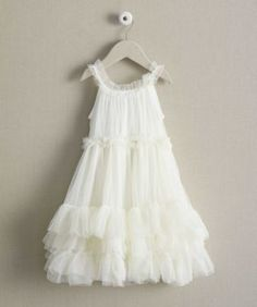 This party dress is made of soft, light-as-fairy-wings tulle, it features ruffly tiers, an elasticized waistband and pretty ruffle straps. Made in USA.