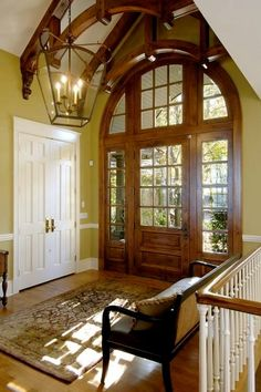 love the open beams and windowed entry!