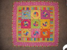 idea of pieced blocks with circles cut out.  double faced with dryer sheets or really thin fabric? Old Days - Old Ways: something from nothing
