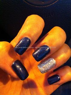 Acrylic nail extensions with gel polish and silver glitter