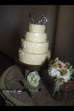 """4 tier peach and ivory wedding cake, 12"""" 10"""" 8"""" and 6"""". The 12,8,6 are vanilla with raspberry filling and vanilla butter cream, the 10"""" is chocolate with chocolate filling and vanilla butter cream, all with fondant lace accents"""