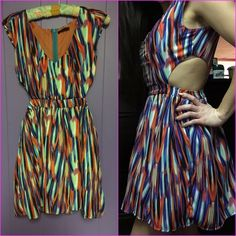 Colorful Cut Out Dress Fun, flirty, multi-colored dress with cutouts on the waist.  Skirt has tool underneath for a fuller effect. This dress is a blast in a glass!! Cals Dresses Mini