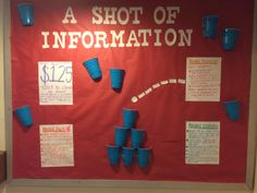 A shot of information alcohol awareness bulletin board. Cut slits in the sides of the cup to staple on the board. Easier than tape if you don't have liquid glue.