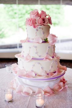 Pretty floral cake decorated with rose petals. Photography courtesy of Taralea Cutler of Eyecontact Photography.