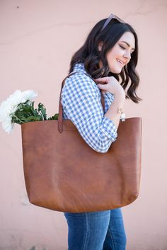 Madewell Flea Market Flare and East West Transport Tote - via @maeamor blue gingham button down, leather tote, flares, pink wall, flowers