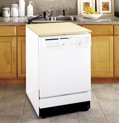 Portable dishwasher.....Roll to the sink and connect to the facet! We had one.