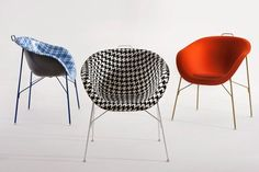 EU/PHORIA Chair by Paola Navone for Eumenes. A monocoque chair created with the idea of using Woodstock® – a material made of wood dust and polypropylene, normally employed in the automobile industry