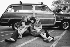 remember when people took their family's photo in front of a car?