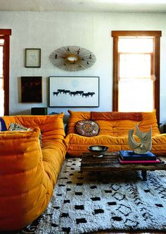 "Elle Decoration August 2015 Shayne Blue's Los Angeles home Photography : Martin Lof Orange ""Togo"" sofa: Michel Ducaroy for Ligne Roset"