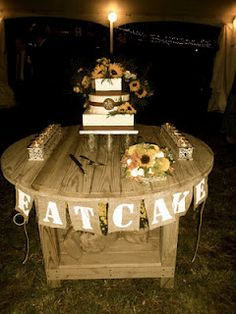 cake table. Love the sign. Use same paper that is used to make bridal flowers instead of burlap.