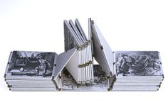 Article: Alchemical Book Artists at Work, Part 2: Daniel Kelm, Image: Daniel Kelm, Neo Emblemata Nova, 2005. 3 x 3 x 3 in. Materials: paper and paper board; iron wire; brass tubing; brass and stainless steel hinges; acrylic paint; solder. Photographer: Jeff Derose, One Match Films. Text and images by Michael Maier (1618). Techniques: wire edge binding; offset printing; laser welding; spattering; soldering. The book is constructed as a Möbius strip ...